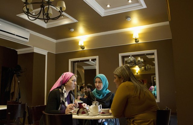 Chechen women chat in a cafe in the centre of the Chechen capital Grozny April 23, 2013. (Photo by Maxim Shemetov/Reuters)