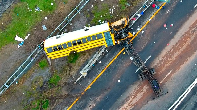 In this aerial photo, a school bus lies crashed on Route 80 in Mount Olive, N.J., Thursday, May 17, 2018. The Paramus school district says the bus was taking students on Thursday from East Brook Middle School to Waterloo Village, a historic site near the crash scene. The yellow school bus was carrying 38 students and seven adults when it crashed, killing a student and a teacher. (Photo by Andre Malok/NJ Advance Media via AP Photo)