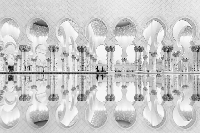 """""""Light and shadows, Abu Dhabi"""". The reflections augment the geometry and architecture of Sheikh Zayed's Grand Mosque in Abu Dhabi. Second place: Architecture. (Photo by Ali Al Jajri/SIPA Contest)"""