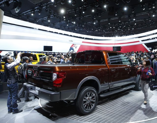 Members of the media surround the 2016 Nissan Titan pickup truck after it was unveiled at the first press preview day of the North American International Auto Show in Detroit, Michigan, January 12, 2015. (Photo by Mark Blinch/Reuters)