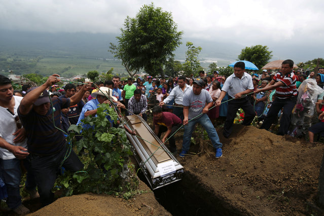 People attend the funeral of 17 year old Aura Yolanda Perez Paz, who died during the eruption of the Fuego volcano in Alotenango, Guatemala June 12, 2018. (Photo by Jose Cabezas/Reuters)
