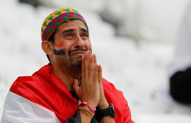 An Egypt fan reacts after they lost the Russia 2018 World Cup Group A football match between Saudi Arabia and Egypt at the Volgograd Arena in Volgograd on June 25, 2018. (Photo by Darren Staples/Reuters)