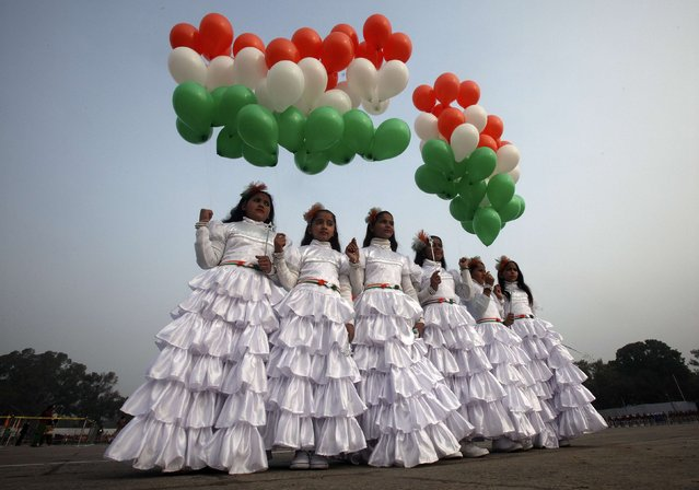 School children holding tri-coloured balloons take part in the Republic Day celebrations in the northern Indian city of Chandigarh January 26, 2015. (Photo by Ajay Verma/Reuters)