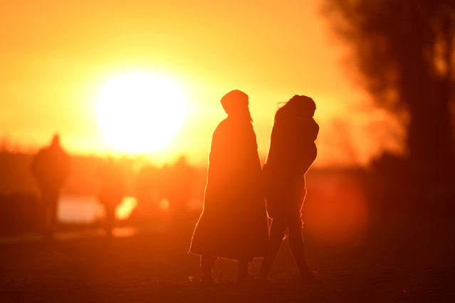 People enjoy the sunset at the Elbe river in Hamburg Germany March 20, 2018. (Photo by Fabian Bimmer/Reuters)