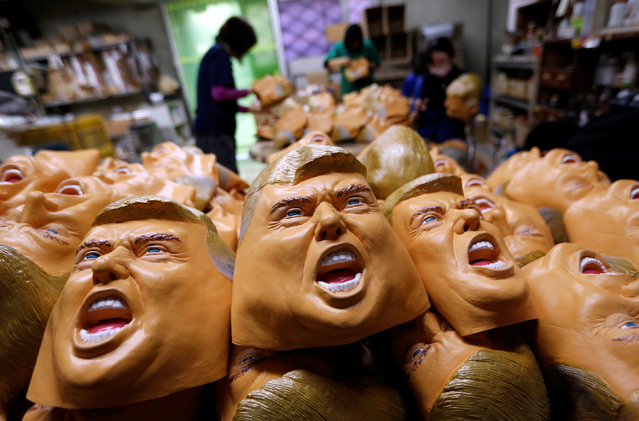 Workers of Ogawa Studios, a mask making company, give the final touches to masks depicting U.S. President-elect Donald Trump at its studio in Saitama, Japan, November 21, 2016. (Photo by Toru Hanai/Reuters)