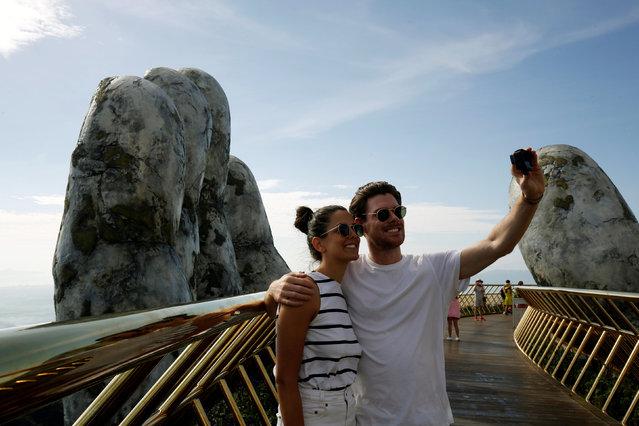 Tourists take photo on Gold Bridge on Ba Na hill near Danang city, Vietnam on August 1, 2018. (Photo by Reuters/Kham)