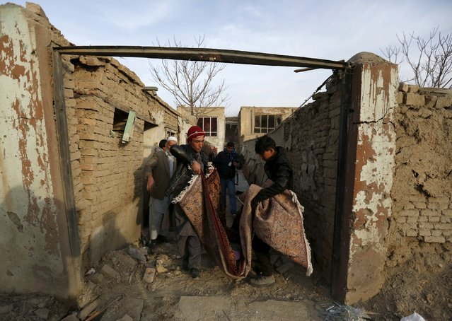 """Afghan residents remove broken glass from their home after a suicide attack in French restaurant  """"Le Jardin"""" in Kabul, Afghanistan January 2, 2016. (Photo by Mohammad Ismail/Reuters)"""