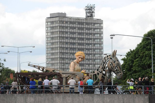 A 20ft puppet of Lady Godiva, which was taken to the London 2012 Olympics to represent the West Midlands in arts and culture makes it's return to Coventry as it travels around the city ring road, on August 10, 2013. (Photo by Joe Giddens/PA Wire)