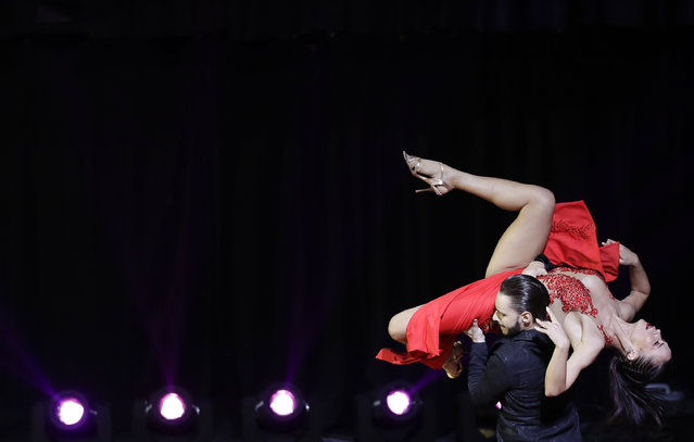 Russian couple Dmitii Kuznetsov and Olga Nikolaeva compete in the stage category at the World Tango Championship final in Buenos Aires, Argentina, Wednesday, August 22, 2018. (Photo by Natacha Pisarenko/AP Photo)