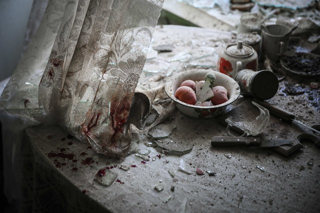 Sergei Ilnitsky, a Russian photographer of the European Pressphoto Agency, won the First Prize in the General News Category, Singles, of the 2015 World Press Photo contest with this image of damaged goods lying in a kitchen in downtown Donetsk, in this picture taken August 26, 2014 and released by the World Press Photo on February 12, 2015. (Photo by Sergei Ilnitsky/EPA/World Press Photo)