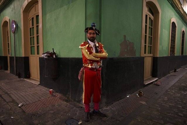 Jose Pereira, 29, a reveller in a bullfighter fancy dress costume, poses for a portrait during the Carnival of Cadiz, southern Spain February 17, 2015. The carnival will run until February 22. (Photo by Marcelo del Pozo/Reuters)