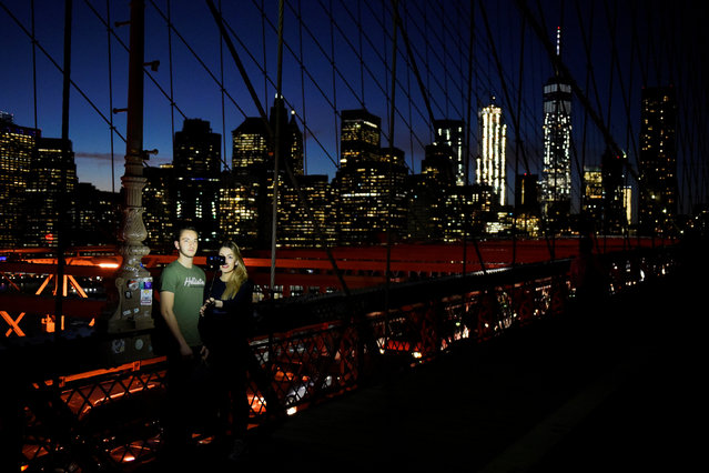 Quentin Brian and Marine Brian take a selfie on the Brooklyn Bridge over the East River between the boroughs of Brooklyn and Manhattan in New York City, U.S. November 18, 2016. (Photo by Mark Kauzlarich/Reuters)