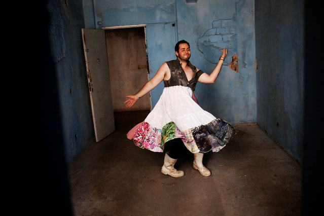 Fernando, 24, who is among members of lesbian, gay, bisexual and transgender (LGBT) community, that have been invited to live in a building that the roofless movement has occupied, poses for a portrait, in downtown Sao Paulo, Brazil, November 26, 2016. A multi-coloured gay pride flag hangs in a corner of a bare room in an abandoned Sao Paulo art deco building that was once the headquarters of Brazil's social security agency. The room is home to several members of Brazil's lesbian, gay, bisexual and transgender community seeking refuge from discrimination and hate crimes against LGBT people. They were invited to join some 300 squatters who have been living in the building for several months in an occupation organised by Front in the Fight for Housing, an activist group promoting rights of some 400,000 people without decent housing in Sao Paulo. Brazil has one of the world's highest rates of LGBT hate crimes, despite a reputation for sexual tolerance. The country recognised same-s*x marriage in 2013 and hosts some of the world's largest gay pride festivals. (Photo by Nacho Doce/Reuters)