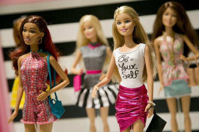 In this September 29, 2015, file photo, Barbie Fashionista Dolls from Mattel are displayed at the TTPM Holiday Showcase in New York. Mattel Inc., the maker of the famous plastic Barbie doll, says it will start selling Barbie's in three new body types: tall, curvy and petite. She'll also come in seven skin tones, 22 eye colors and 24 hairstyles. The El Segundo, Calif., toy company will also continue to sell the original Barbie. (Photo by Mark Lennihan/AP Photo)