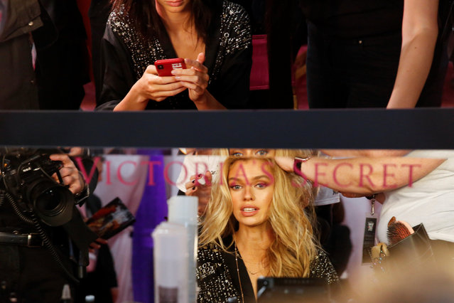 Stella Maxwell is prepared backstage during the Victoria's Secret fashion show in the Manhattan borough of New York City, U.S., November 8, 2018. (Photo by Caitlin Ochs/Reuters)