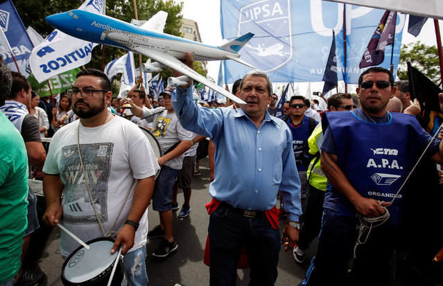 Airline workers protest against the government's plan to operate domestic and international flights in Argentina by low-cost airlines in Buenos Aires, Argentina, December 27, 2016. (Photo by Agustin Marcarian/Reuters)