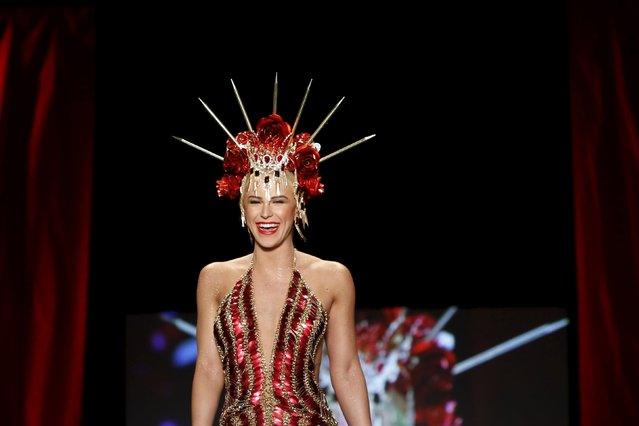 Gigi Gorgeous presents a creation during the American Heart Association's (AHA) Go Red For Women Red Dress Collection, presented by Macy's at New York Fashion Week February 11, 2016. (Photo by Andrew Kelly/Reuters)