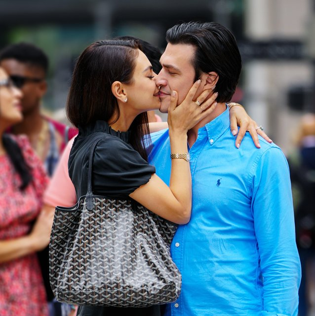 """Mila Kunis and Finn Wittrock are spotted filming on 5th Avenue for """"Luckiest Girl Alive"""" in New York City on August 28, 2021. The 38 year old American actress looked fashionable in a black cocktail dress and tan wedges as they stopped for a passionate embrace and kiss on the busy sidewalk. (Photo by The Image Direct)"""