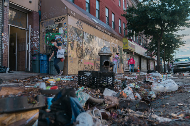 Debris are seen on Knickerbocker Avenue after heavy rains from storm Ida caused flooding in Brooklyn, New York on September 2, 2021. (Photo by Jeenah Moon for The Washington Post)