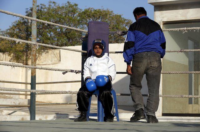 Aamna, 11, waits for the start for her bout during the Sindh Junior Sports Association Boxing Tournament in Karachi, Pakistan February 21, 2016. (Photo by Akhtar Soomro/Reuters)