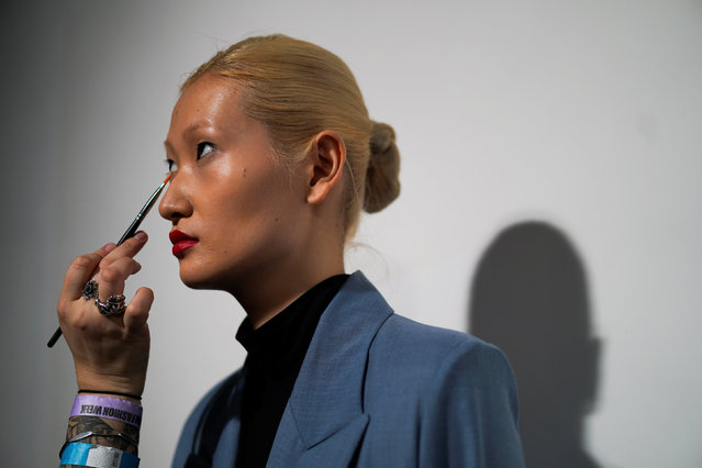 A odel prepares backstage of the Marta Jakubowski show during London Fashion Week Women's A/W19 in London, Britain February 15, 2019. (Photo by Henry Nicholls/Reuters)