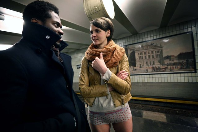 Participants inf the No Pants Subway Ride wait for a train in Berlin. (Photo by Adam Berry/Getty Images)