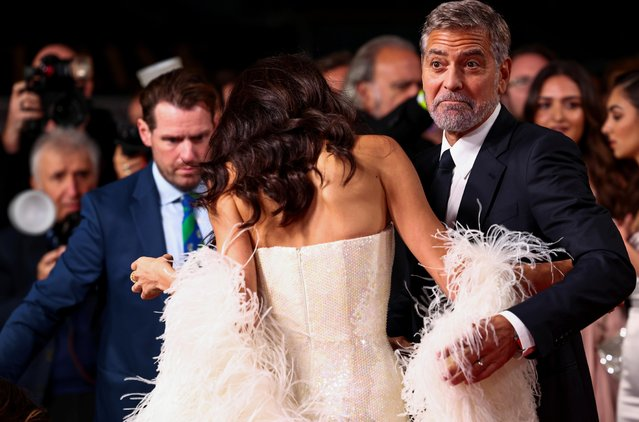 """Director George Clooney reacts as he and his wife lawyer Amal Clooney arrive for a screening of the film """"The Tender Bar"""" as part of the BFI London Film Festival, in London, Britain, October 10, 2021. (Photo by Henry Nicholls/Reuters)"""