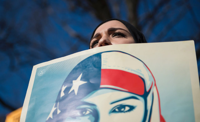 Isra C., of Washington DC, who did not want to give her last name, takes part in a protest outside the White House on February 4, 2017, in Washington, DC. The demonstrators protested US President Donald Trump' s travel ban on nationals from seven Muslim- majority countries. (Photo by Molly Riley/AFP Photo)