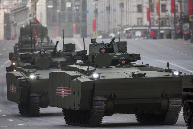 New Russian military vehicles make their way to Red Square during a rehearsal for the Victory Day military parade which will take place at Moscow's Red Square on May 9 to celebrate 70 years after the victory in WWII, in Moscow, Russia, Monday, May 4, 2015. The military parade takes place on Saturday, the 70th anniversary of the victory over Nazi Germany in World War II. (Photo by Alexander Zemlianichenko/AP Photo)