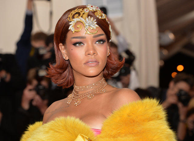 "Rihanna arrives at The Metropolitan Museum of Art's Costume Institute benefit gala celebrating ""China: Through the Looking Glass"" on Monday, May 4, 2015, in New York. (Photo by Evan Agostini/Invision/AP Photo)"