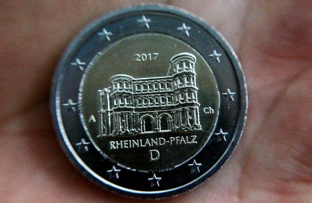 A newly designed 2-Euro coin is pictured during a presentation at the Chancellery in Berlin, Germany February 10, 2017. (Photo by Hannibal Hanschke/Reuters)