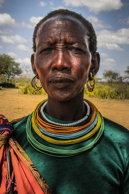 A Pokot tribeswoman: the Pokot and Karamojong have a long history of clashes and still now there is tension between both tribes. In Amudat, home to the Pokot, there is slightly greener grass but the Karamojong will not graze there, Karamoja, Uganda, February, 2017. (Photo by Sumy Sadurni/Barcroft Images)