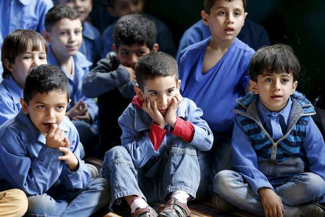 Kids watch a theater puppet show at an UNRWA school in Burj al-Barajneh in Beirut May 14, 2015. (Photo by Mohamed Azakir/Reuters)