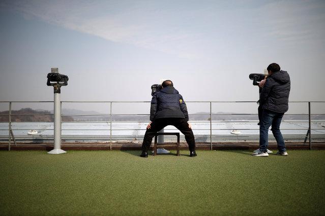 Tourists look toward the north through binoculars near the demilitarized zone separating the two Koreas in Paju, South Korea, February 27, 2019. (Photo by Kim Hong-Ji/Reuters)