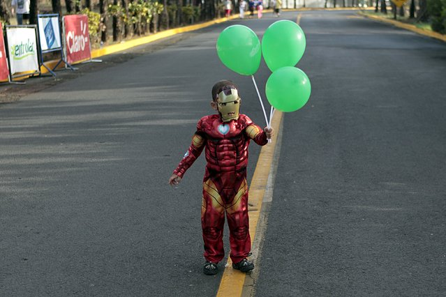A child dressed as Iron Man takes part in a charity run raising funds for the treatment of children with cancer at the children's hospital in Managua May 17, 2015. (Photo by Oswaldo Rivas/Reuters)
