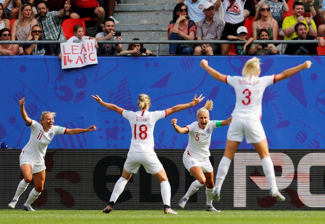 Steph Houghton of England celebrates her first goal with her teammates during the 2019 FIFA Women's World Cup France Round Of 16 match between England and Cameroon at Stade du Hainaut on June 23, 2019 in Valenciennes, France. (Photo by Phil Noble/Reuters)