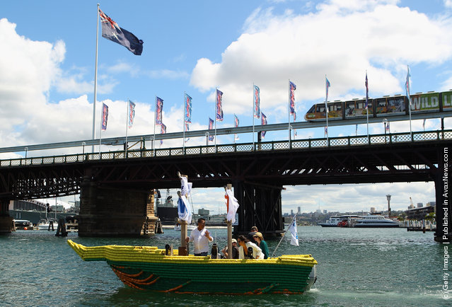Darwin's Beer Can Boat Cruises Into Sydney Harbour