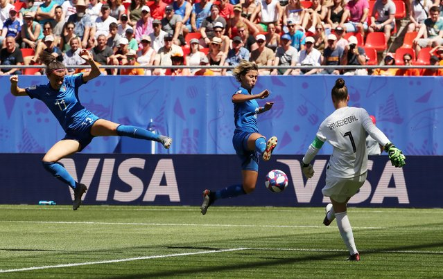 Netherlands goalkeeper Sari Van Veenendaal, right, makes a save in front of Italy's Barbara Bonansea, front left, and Italy's Valentina Giacinti during the Women's World Cup quarterfinal soccer match between Italy and the Netherlands, in Valenciennes, France, Saturday, June 29, 2019. (Photo by Yves Herman/Reuters)