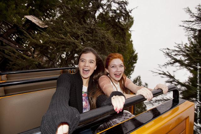 Actress Hailee Steinfeld and fashion blogger Tavi Gevinson ride Big Thunder Mountain Railroad at Disneyland park