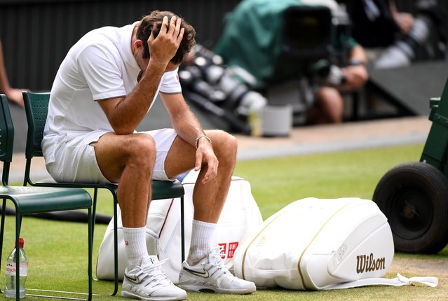 Roger Federer of Switzerland reacts following defeat in his Men's Singles final against Novak Djokovic of Serbia during Day thirteen of The Championships – Wimbledon 2019 at All England Lawn Tennis and Croquet Club on July 14, 2019 in London, England. (Photo by Matthias Hangst/Getty Images)