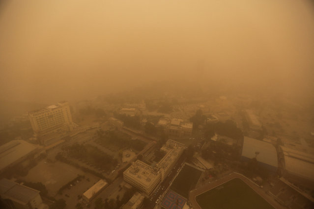 A sandstorm shrouds the capital city of Cairo, Egypt, Saturday, June 27, 2015. (Photo by Mosa'ab Elshamy/AP Photo)