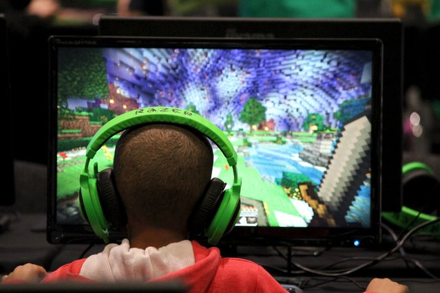 A child plays video game Minecraft at the Minecon convention in London July 4, 2015. The 10,000 tickets sold for Minecon in London made it the largest ever convention for a single video game. (Photo by Matthew Tostevin/Reuters)