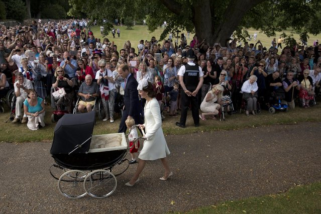 Britain's Prince William, Kate the Duchess of Cambridge, with son Prince George and daughter Princess Charlotte in a pram arrive for Charlotte's Christening at St. Mary Magdalene Church in Sandringham, England, Sunday, July 5, 2015. (Photo by Matt Dunham/AP Photo)