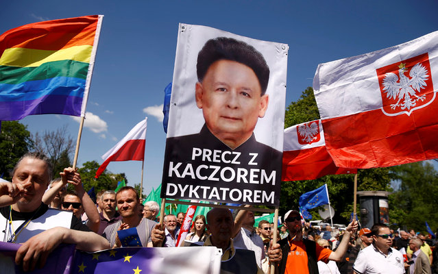 A man holds a poster depicting the leader of the Law and Justice party Jaroslaw Kaczynski as North Korean leader Kim Jong-un during an anti-government demonstration organized by main opposition parties in Warsaw, Poland May 7, 2016. (Photo by Kacper Pempel/Reuters)