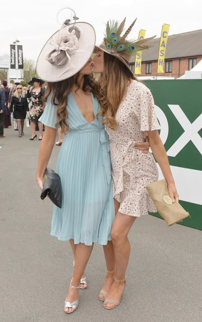 Two female pals puckered up while wandering around the course in their pretty summer frocks during the Grand National Festival at Aintree Racecourse on April 7, 2017 in Liverpool, England. (Photo by Dave Nelson)
