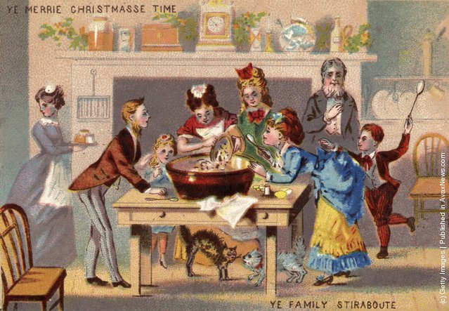 A Victorian family gather to stir the Christmas pudding for luck.  Christmas card of 1871 or 1872