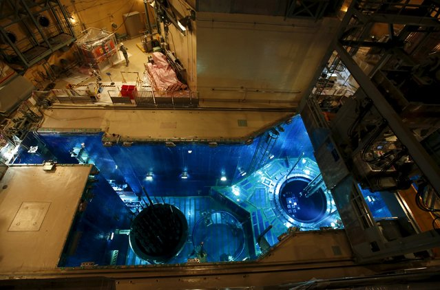 A fuel rod is inserted into a reactor vessel (R) inside the No.1 reactor building at Kyushu Electric Power's Sendai nuclear power station in Satsumasendai, Kagoshima prefecture, Japan, July 8, 2015. (Photo by Issei Kato/Reuters)