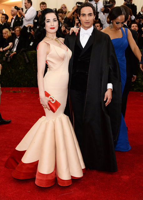 "Dita Von Teese (L) and designer Zac Posen attend the ""Charles James: Beyond Fashion"" Costume Institute Gala at the Metropolitan Museum of Art on May 5, 2014 in New York City. (Photo by Dimitrios Kambouris/Getty Images)"