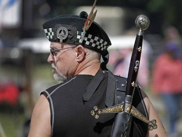 Stephen Morrison, of Johnson City, Tenn., walks through the grounds during the 59th annual Grandfather Mountain Highland Games in Linville, N.C., Friday, July 10, 2015. (Photo by Chuck Burton/AP Photo)