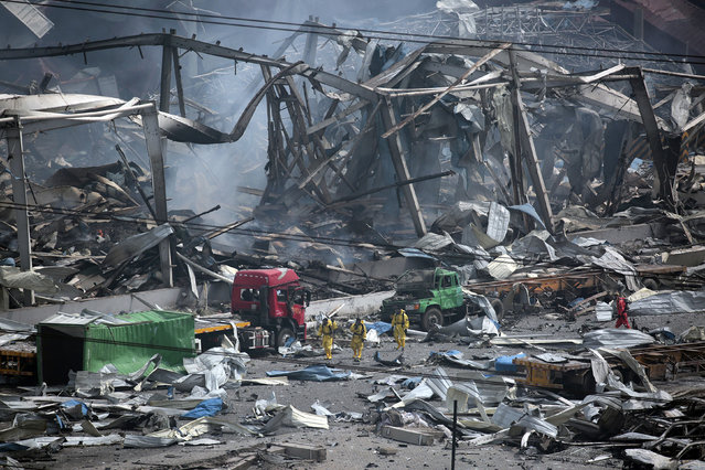 Chemical blasts in the Chinese port city of Tianjin killed 165 people in 2015. The government put the losses in the 10th busiest port in the world at more than $1 billion. An official report on the disaster blamed the ignition of hazardous materials which had been improperly or illegally stored on site. Company executives also said they used their connections to get fire safety and environmental approvals through unofficial channels. Anger over safety standards is growing in China, after three decades of swift economic growth marred by incidents from mining disasters to factory fires. President Xi Jinping has vowed that authorities will learn lessons. (Photo by Jason Lee/Reuters)